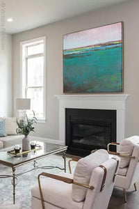 "Teal green abstract landscape painting ""Siesta Seas,"" canvas wall art by Victoria Primicias, decorates the fireplace."