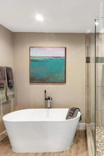 "Load image into Gallery viewer, Teal green abstract beach artwork ""Siesta Seas,"" giclee print by Victoria Primicias, decorates the bathroom."
