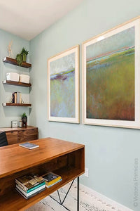 "Impressionist abstract coastal wall art ""Silent Spring,"" digital art landscape by Victoria Primicias, decorates the office."