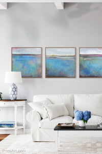 "Colorful abstract beach wall art ""Silver Sands,"" digital art landscape by Victoria Primicias, decorates the living room."
