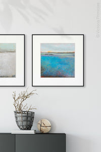 "Turquoise abstract seascape painting ""Silver Sands,"" wall art print by Victoria Primicias, decorates the entryway."