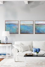 "Load image into Gallery viewer, Turquoise abstract beach wall art ""Silver Sands,"" fine art print by Victoria Primicias, decorates the living room."