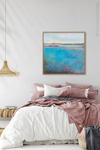 "Large coastal abstract ocean wall art ""Silver Sands,"" original art by Victoria Primicias, hangs above the bed."