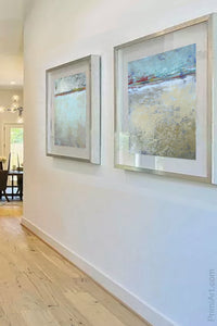 "Seafoam and gray abstract ocean painting ""Silver Springs,"" giclee print by Victoria Primicias, decorates the hallway."