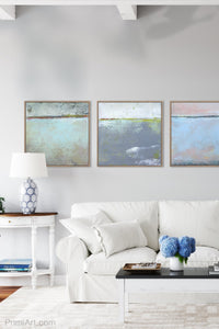 "Seafoam and gray abstract ocean painting ""Silver Springs,"" fine art print by Victoria Primicias, decorates the living room."