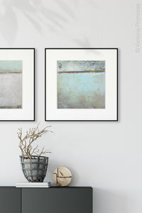 "Seafoam and gray abstract beach painting ""Silver Springs,"" wall art print by Victoria Primicias, decorates the entryway."