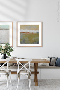 "Modern abstract ocean art ""Singing Surf,"" digital print by Victoria Primicias, decorates the dining room."