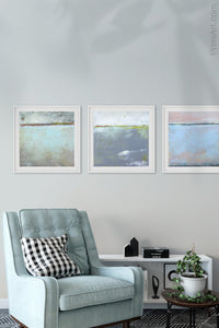 "Pastel abstract coastal wall decor ""Sister Shore,"" digital art landscape by Victoria Primicias, decorates the living room."