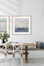 "Load image into Gallery viewer, Gray abstract coastal wall art ""Splintered Memory,"" canvas print by Victoria Primicias, decorates the dining room."