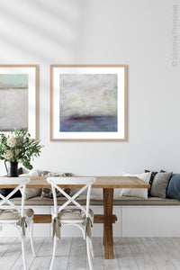 "Gray abstract coastal wall art ""Splintered Memory,"" canvas print by Victoria Primicias, decorates the dining room."