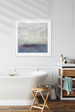 "Load image into Gallery viewer, Gray abstract coastal wall art ""Splintered Memory,"" canvas print by Victoria Primicias, decorates the bathroom."