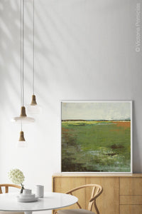 "Green abstract landscape art ""Spring Envy,"" wall art print by Victoria Primicias, decorates the dining room."