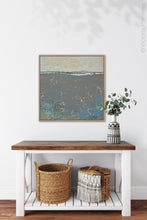 "Load image into Gallery viewer, Modern abstract ocean painting ""Still Suede,"" downloadable art by Victoria Primicias, decorates the hallway."