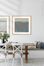 "Load image into Gallery viewer, Modern abstract ocean painting ""Still Suede,"" digital print by Victoria Primicias, decorates the dining room."