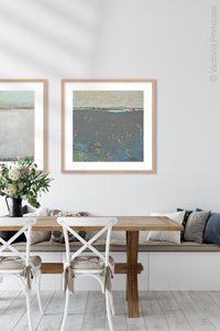 "Modern abstract ocean painting ""Still Suede,"" digital print by Victoria Primicias, decorates the dining room."