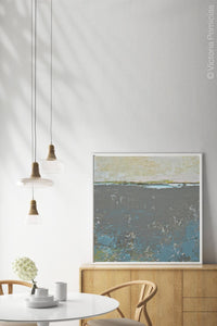 "Modern abstract ocean art ""Still Suede,"" downloadable art by Victoria Primicias, decorates the dining room."