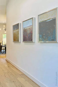 "Modern abstract ocean art ""Still Suede,"" digital print by Victoria Primicias, decorates the hallway."