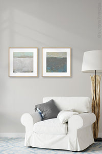 "Gray abstract ocean art ""Still Suede,"" metal print by Victoria Primicias, decorates the living room."