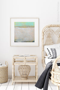 "Mint and gray abstract beach wall art ""Sunday Morning,"" metal print by Victoria Primicias, decorates the shelf."