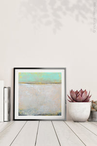 "Mint and gray abstract beach wall decor ""Sunday Morning,"" metal print by Victoria Primicias, decorates the shelf."