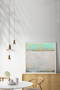 "Mint and gray abstract beach wall art ""Sunday Morning,"" metal print by Victoria Primicias, decorates the dining room."