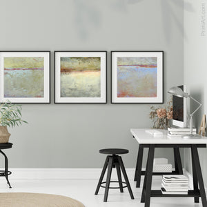 "Muted beige abstract ocean art ""Sweet Compass,"" digital download by Victoria Primicias, decorates the office."