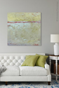 "Muted beige abstract ocean painting ""Sweet Compass,"" digital download by Victoria Primicias, decorates the living room."