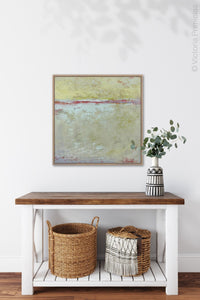 "Muted beige abstract ocean art ""Sweet Compass,"" digital download by Victoria Primicias, decorates the entryway."