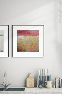 "Red and gold abstract landscape art ""Tangerine Light,"" canvas print by Victoria Primicias, decorates the kitchen."