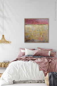 "Red and gold abstract ocean painting ""Tangerine Light,"" canvas wall art by Victoria Primicias, decorates the bedroom."