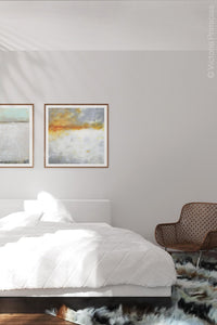 "Contemporary abstract landscape art ""Tawny Spirit,"" digital download by Victoria Primicias, decorates the bedroom."