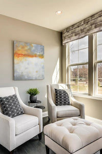 "Contemporary abstract landscape art ""Tawny Spirit,"" digital print by Victoria Primicias, decorates the living room."