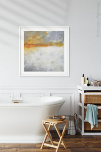 "Contemporary abstract ocean painting ""Tawny Spirit,"" digital art landscape by Victoria Primicias, decorates the bathroom."