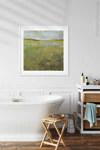 "Yellow green abstract beach artwork ""Tender Reasons,"" digital art landscape by Victoria Primicias, decorates the bathroom."