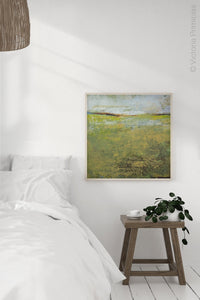 "Yellow green abstract ocean wall art ""Tender Reasons,"" digital art landscape by Victoria Primicias, decorates the bedroom."