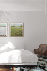 "Yellow green abstract landscape painting ""Tender Reasons,"" digital art landscape by Victoria Primicias, decorates the bedroom."
