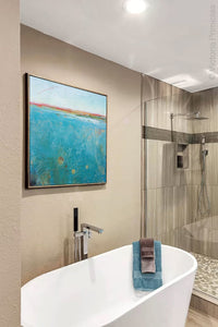 "Teal abstract beach wall art ""Tethered Basin,"" giclee print by Victoria Primicias, decorates the bathroom."