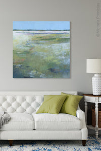 "Large abstract landscape art ""Thirsty Sheets,"" canvas wall art by Victoria Primicias, decorates the living room."