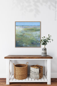 "Large abstract ocean art ""Thirsty Sheets,"" canvas print by Victoria Primicias, decorates the entryway."