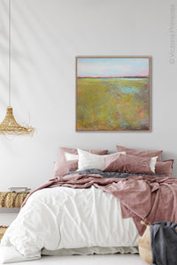 "Chartreuse abstract landscape painting ""Tidal Pools,"" canvas art print by Victoria Primicias, decorates the bedroom."