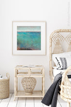 "Load image into Gallery viewer, Colorful abstract beach wall decor ""Tides End,"" digital print by Victoria Primicias, decorates the bedroom."