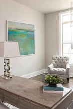 "Load image into Gallery viewer, Teal green abstract beach art ""Tropicana Tales,"" digital artwork by Victoria Primicias, decorates the office."