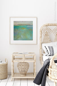 "Teal green abstract beach painting ""Tropicana Tales,"" digital download by Victoria Primicias, decorates the bedroom."