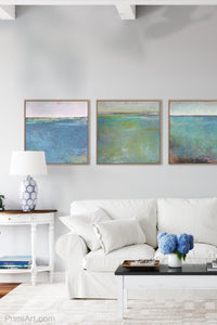 "Teal green abstract beach art ""Tropicana Tales,"" digital art landscape by Victoria Primicias, decorates the living room."