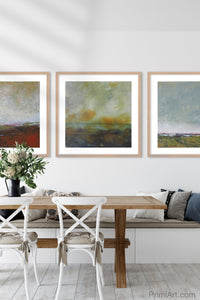 "Modern abstract seascape painting""Tuesday's Tempest,"" digital download by Victoria Primicias, decorates the dining room."