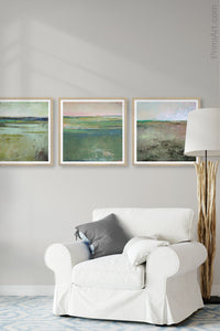 "Square contemporary abstract landscape art ""Tuscan Strands,"" printable wall art by Victoria Primicias, decorates the living room."