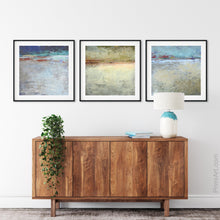 "Load image into Gallery viewer, Gray abstract seascape painting ""Tuscan Treasures,"" digital print by Victoria Primicias, decorates the living room."