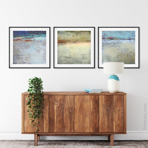 "Gray abstract seascape painting ""Tuscan Treasures,"" digital print by Victoria Primicias, decorates the living room."