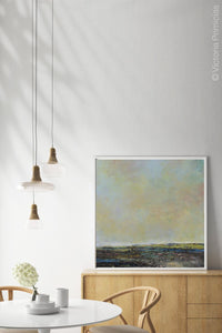 "Serene abstract landscape art ""Twilight Blush,"" digital print by Victoria Primicias, decorates the dining room."