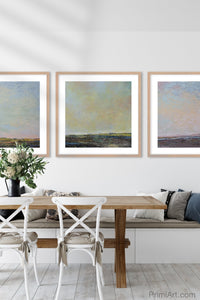 "Serene abstract landscape art ""Twilight Blush,"" digital download by Victoria Primicias, decorates the dining room."